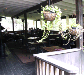 Covered porch offers outside dining